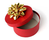 Gift box of red color with a golden bow — Stock Photo