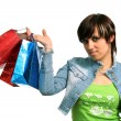 The happy girl with purchases — Stock Photo #14459193