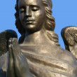 Fragment of a bronze sculpture of a praying angel 5 - Stock Photo