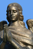 Fragment of a bronze sculpture of a praying angel 5 — Stock Photo