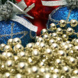 New Year's celebratory ornaments and golden beads — Stock Photo