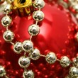 Red glass sphere for a New Year's fur-tree — Stock Photo
