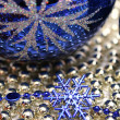 Glass celebratory sphere and blue snowflake — Stockfoto
