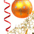 Royalty-Free Stock Photo: Yellow New Year\'s sphere on a background of a tinsel 2