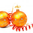 Two New Year's spheres of orange color and red tinsel — Stock Photo #14461141