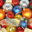 Christmas ornaments of different color and gift ribbons — Stock Photo