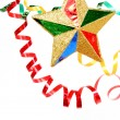 Multi-coloured celebratory tinsel and christmas star on a white — Stock Photo