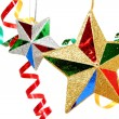 Multi-coloured celebratory tinsel and two christmas stars — Stock Photo