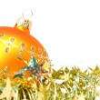Christmas sphere of yellow color and celebratory tinsel 5 — Stock Photo