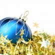 Christmas sphere of dark blue color and tinsel — Stock Photo