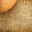 Royalty-Free Stock Photo: Croissant with sesame on a sacking background