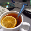 Morning tea with a lemon for the programmer — Stock Photo