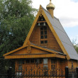 Orthodox wooden chapel with a campanile and the gilt dome 1 — Stock Photo