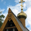Fragment of an orthodox wooden chapel with a campanile 2 — Stock Photo #14468661