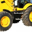 Two wheels of a building tractor — Stock Photo #14468711