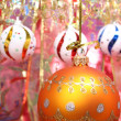 Orange christmas sphere and celebratory ribbon 2 — Stock Photo