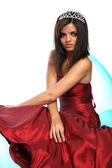 Fille dans une robe de soirée rouge et avec un diadème — Photo