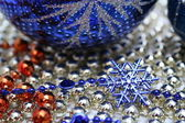 Glass christmas sphere with a pattern and a snowflake — Stock Photo