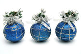 Three christmas spheres of dark blue color — Stock Photo