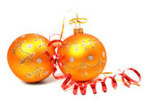 Two New Year's spheres of orange color and red tinsel — Stock Photo