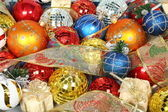New Year's ornaments of different color and gift ribbons 1 — Stock Photo
