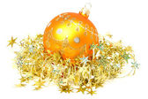 Celebratory sphere of yellow color and golden tinsel — Stock Photo