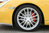 Wheel of new sports car — Stok fotoğraf