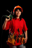 Young woman with work tools and drill — Stock Photo