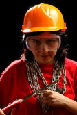 Young woman with chain and saw — Stock Photo