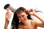 Brunette girl with hair dryer — Stock Photo