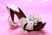 Woman shoes on satin — Stock Photo