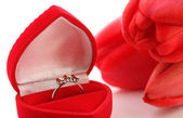Red tulips and Jewelry Box with ring — Stock Photo