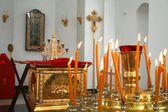 Internal furniture and candles of an orthodox temple 5 — Stockfoto
