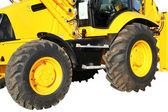 Two wheels of a building tractor — Stock Photo