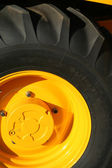 New wheel of a yellow building tractor — Stock Photo