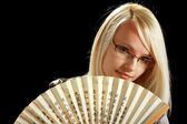 A young attractive woman with fan — Stock Photo