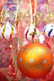 Orange christmas sphere and celebratory ribbon 2 — Stock Photo