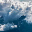 Stock Photo: Clouds over the Mountains Peaks