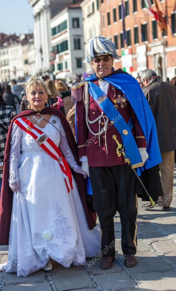 Venice, Italy- February 26th, 2011: A mature couple disguised in medieval Austrian military clothes on Sestiere Castello in Venice during the Carnival days.  Stock Photo #15765865