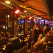 Crowd of on a French Terrace — Stock Photo