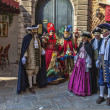 Venice,Italy- February 18, 2012: Group of disguised wearing various costumes and masks during The Venice Carnival. — Stock Photo #19265535