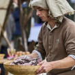 Medieval Man Preparing Food - Stock Photo