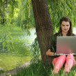Young Woman Studying Outside — Stockfoto