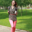 Young Woman Running in a Park — Stockfoto