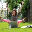 Happy Woman with Computer in an Urban Park — Stockfoto