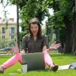 Happy Young Woman on a Laptop — Stock Photo