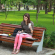 Young Woman Studying in a Park — Stock Photo #33114039