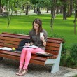 Young Woman Studying in a Park — Stok fotoğraf