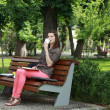 Woman Drinking Coffee in a Park — Stock Photo
