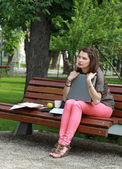 Young Woman with a Laptop in the Park — Stock Photo